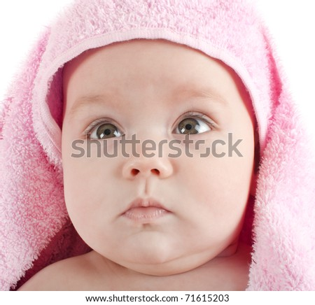 Cute baby with pink towel  close up - stock photo