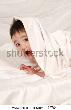 cute baby wrapped in bath towel - stock photo