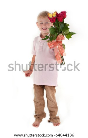 Cute barefoot boy with a rose bouquet in his hands - stock photo