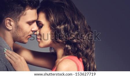 cute beautiful couple posing in a studio. closeup - stock photo