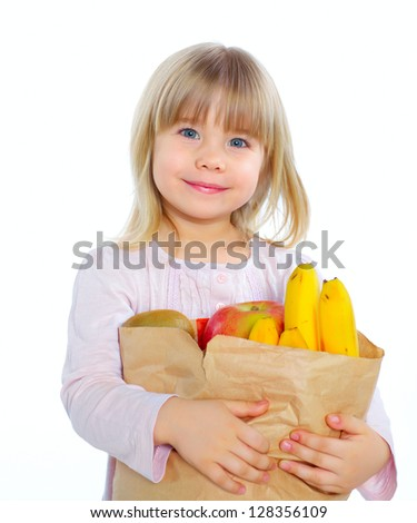 Cute beautiful girl with fruits in basket, isolated on white - stock photo
