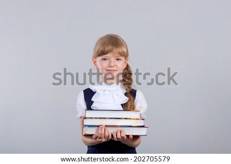 Cute beautiful schoolgirl with books - stock photo