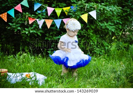 Cute birthday girl on party background - stock photo