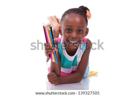 Cute black african american little girl holding color pencil, isolated on white background - African people - Children - stock photo