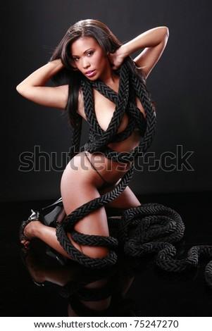 Cute black girl dressed with marine rope - stock photo