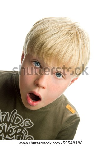 Cute blond boy with surprised expression, isolated on white background - stock photo