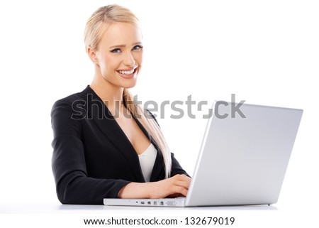Cute blond business woman working on laptop computer - stock photo