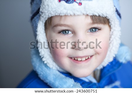 Cute blond caucasian boy smiling - stock photo