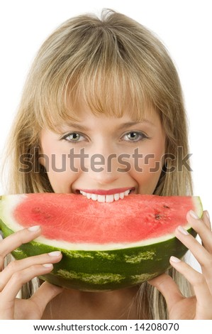 cute blond girl in red dress and red lips eating a piece of water melon