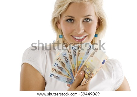 cute blond girl smiling behind a fun of euro money. FACE NOT IN FOCUS . FOCUS ON THE MONEY . - stock photo