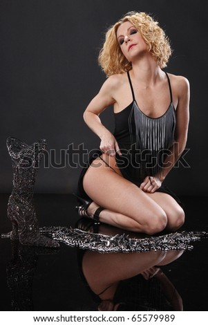 Cute blond lays on the floor with fashionable accessories - stock photo