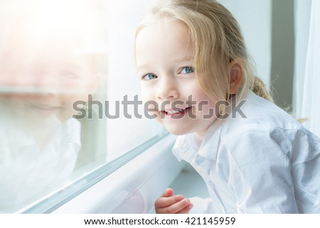 Cute blond pre school girl smiling portrait - stock photo