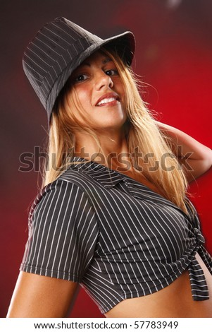 Cute blond with hat on red - stock photo