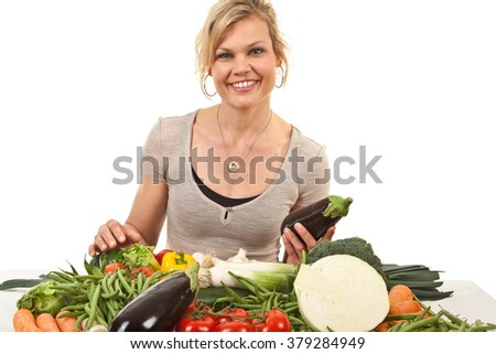 Cute blond with vegetables girl shot in studio with white background