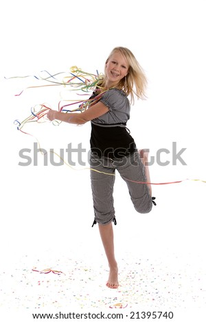 Cute blond young teenage girl dancing on a floor covered in confetti - stock photo
