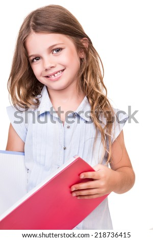 Cute blonde girl grabbing pink book over white