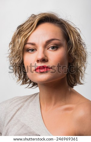 Cute blonde girl posing in the studio. Beautiful blue eyes. girl with blue eyes. Beauty, beauty, fashion. Photo Catalog. Portrait of a young girl. Girl with beautiful healthy hair. - stock photo