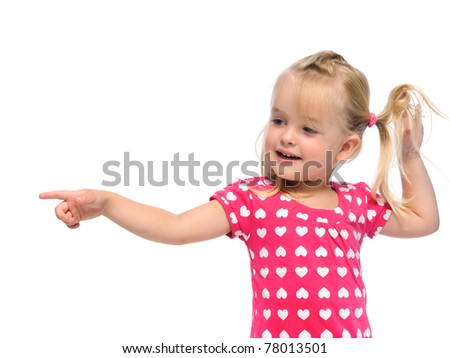 cute blonde girl with pigtails points in a direction, isolated on white in studio - stock photo
