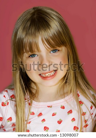 Cute blonde girl with very loose baby teeth. - stock photo