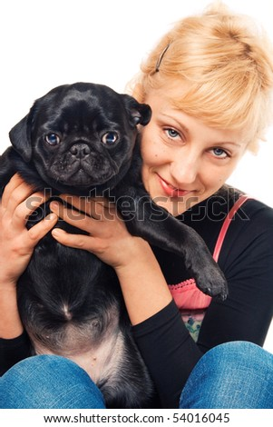 Cute blonde holding a pug - stock photo