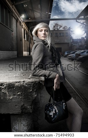 Cute blonde over urban background - stock photo