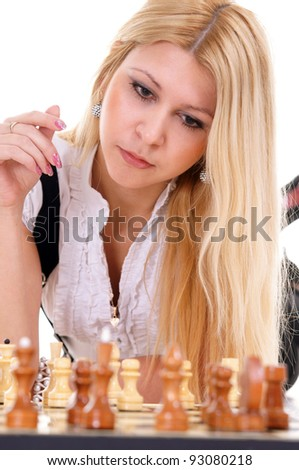 cute blonde playing chess on a white