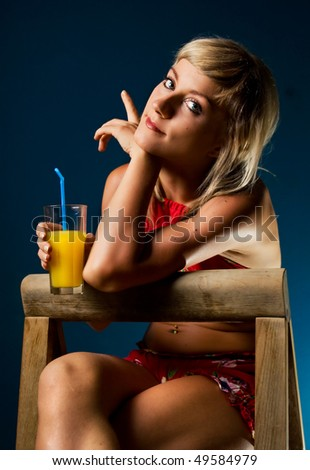 Cute blonde posing with a glass of juice - stock photo