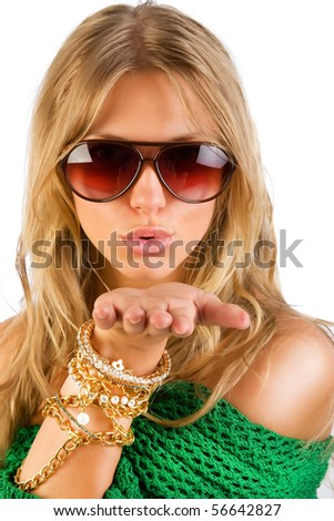 Cute blonde wearing sunglasses and sending a kiss - stock photo