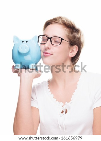 cute blonde woman cuddling with a piggy bank on white background - stock photo