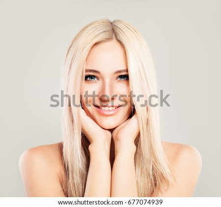 Cute Blonde Woman Fashion Model with Blonde Hair Smiling. Beautiful Girl, Pretty Face