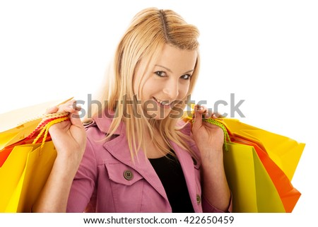 Cute blonde woman with shopping vibrant bags isolated over white background studio shot