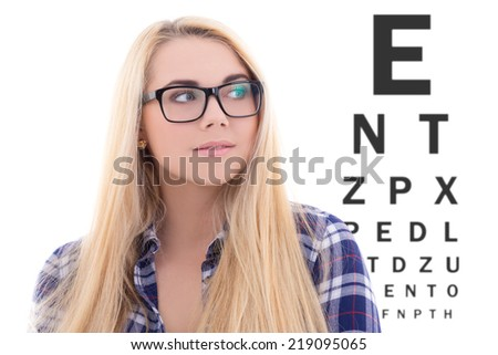 cute blondie girl in eyeglasses on the background of eye test chart - stock photo