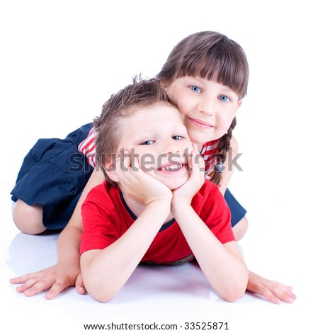 Cute blue-eyed children are playing and posing in studio