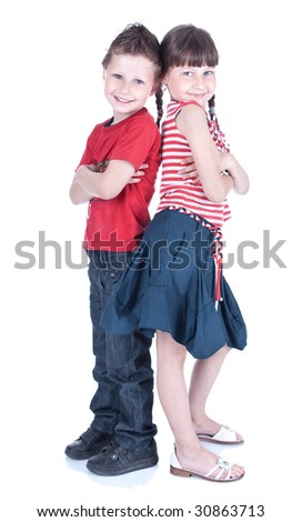 Cute blue-eyed children posing in studio - stock photo