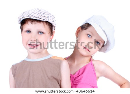 Cute blue-eyed children with whit caps  posing, close up