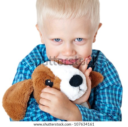 cute boy (age 4 years ) with a soft toy on a white background,