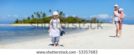 Cute boy and his family on small tropical island - stock photo