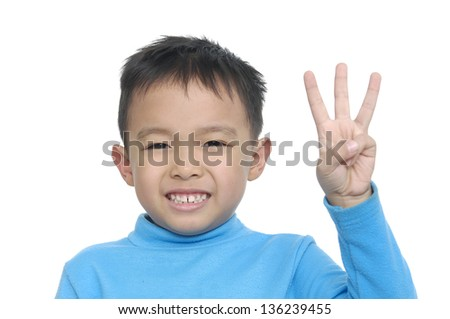 Cute boy and showing three finger isolated on a white background - stock photo
