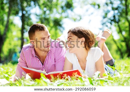 Cute boy and young woman in summer park