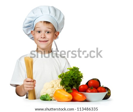 cute boy Chef is holding raw spaghetti. isolated