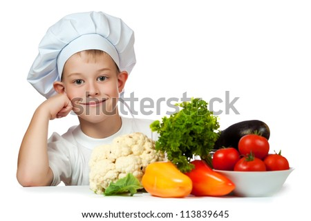 cute boy Chef is smiling. isolated