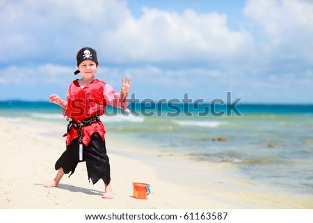 Cute boy dressed as pirate on tropical beach - stock photo