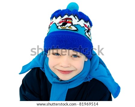 Cute boy dressed in winter clothes isolated on white background - stock photo