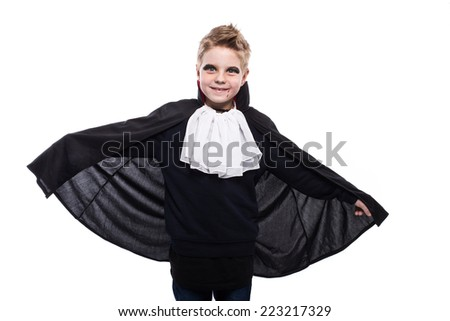 Cute boy dressed up as Dracula for the halloween party. Studio portrait isolated over white background    - stock photo