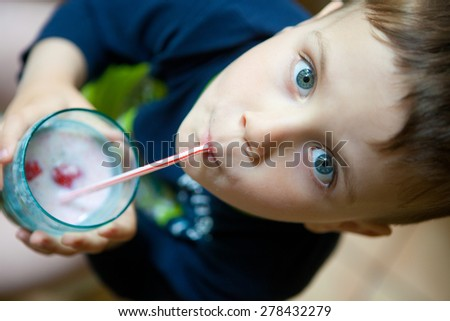 Cute boy drinking smoothie - stock photo