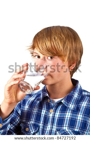 cute boy drinking water out of a glass