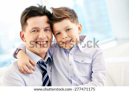 Cute boy embracing his father - stock photo