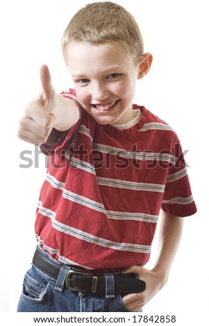 Cute boy giving a thumbs up - stock photo