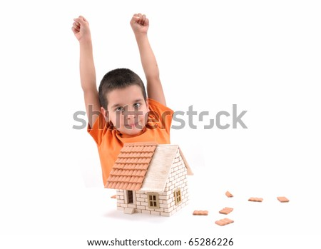 Cute boy happy to built brick house isolated on white - a series of BUILDING A HOUSE  images. - stock photo
