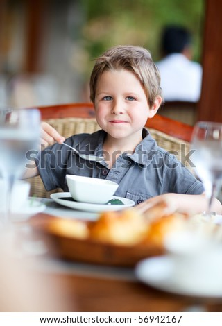Cute boy having delicious breakfast - stock photo